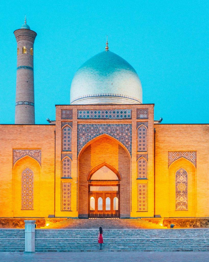 girl standing inside Hazrati Imam Complex at night tashkent uzbekistan
