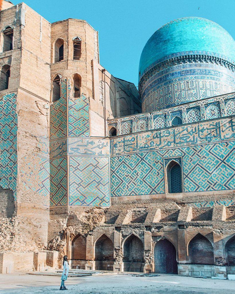 uzbekistan girl standing amongst ruins of bibi khanym mosque