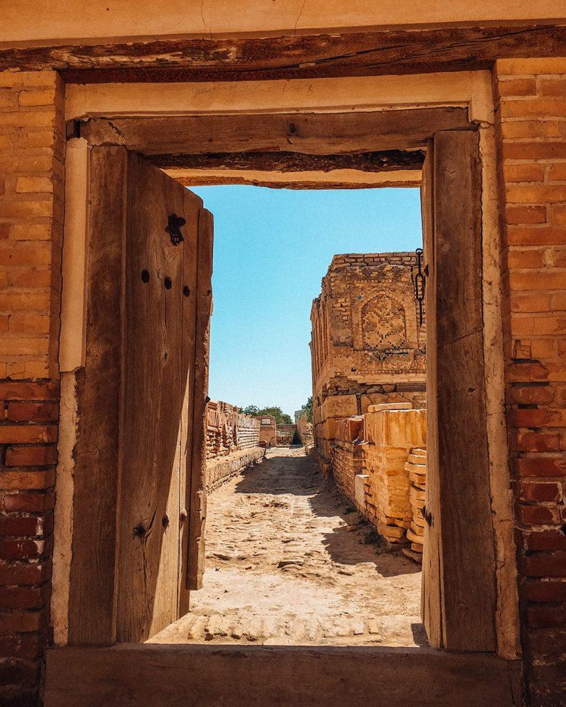 ancient ruins of bukhara uzbekistan seen from a door