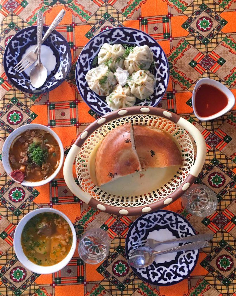 uzbek food on table in samarkand plov manti shurpa lagman