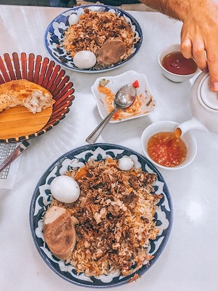 uzbek food on table in plov center in tashkent