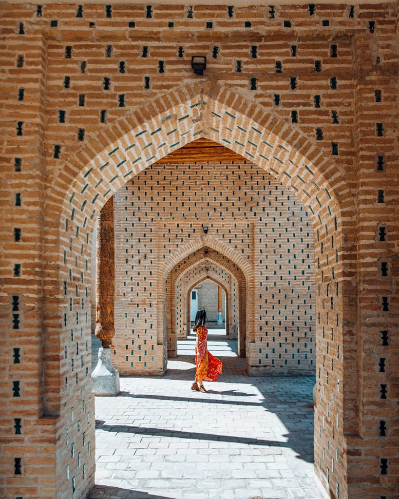 girl standing inside isfandiyar palace  in khiva uzbekistan