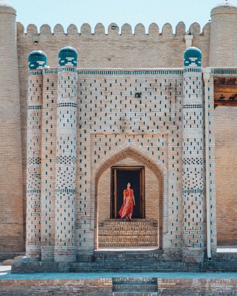 girl standing inside isfandiyar palace in uzbekistan