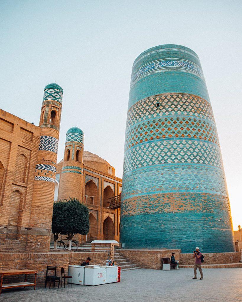 photographer at kalta minor minaret in uzbekistan