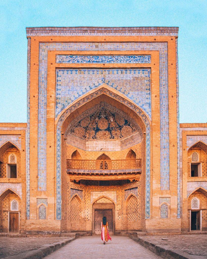 girl walking towards madrasah in uzbekistan