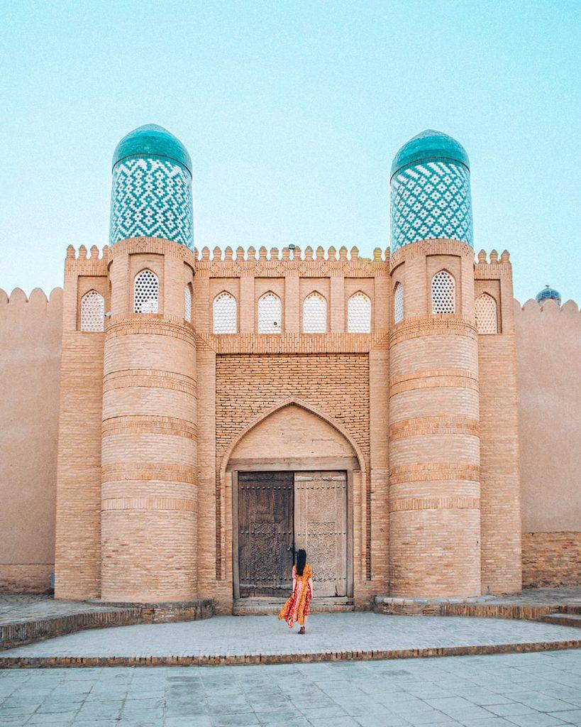girl standing inside kuhna ark fortress in uzbekistan