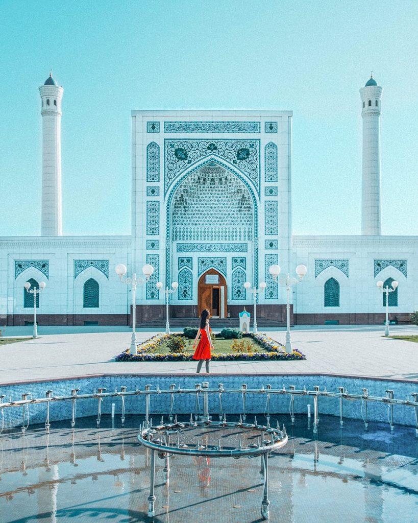 girl standing in front of minor mosque in tashkent uzbekistan