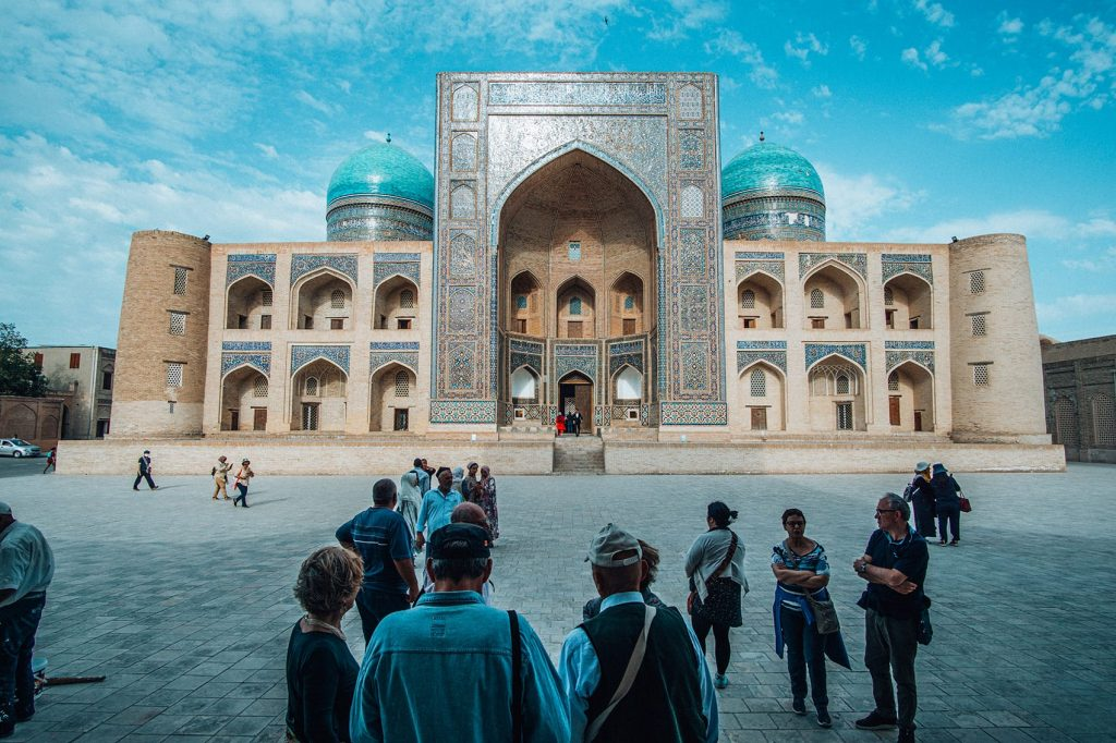 tourists inside po i kalyan complex in bukhara