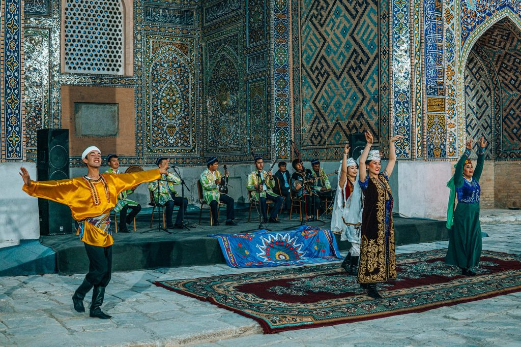 dancers perform traditional uzbek dance at concert in registan square samarkand at night