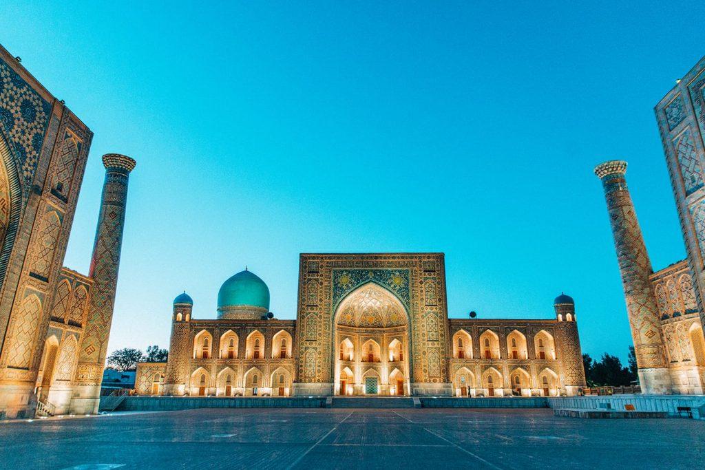 registan square lit up at night uzbekistan