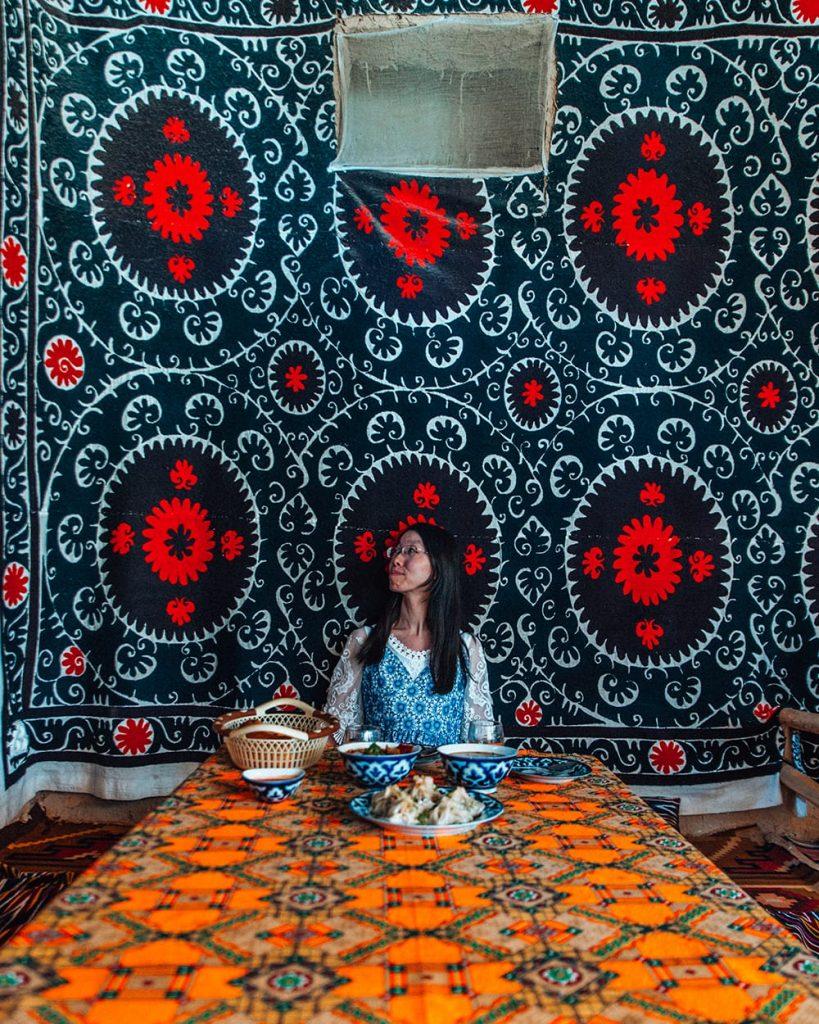 uzbek food in stylish samarkand restaurant next to wall decorations