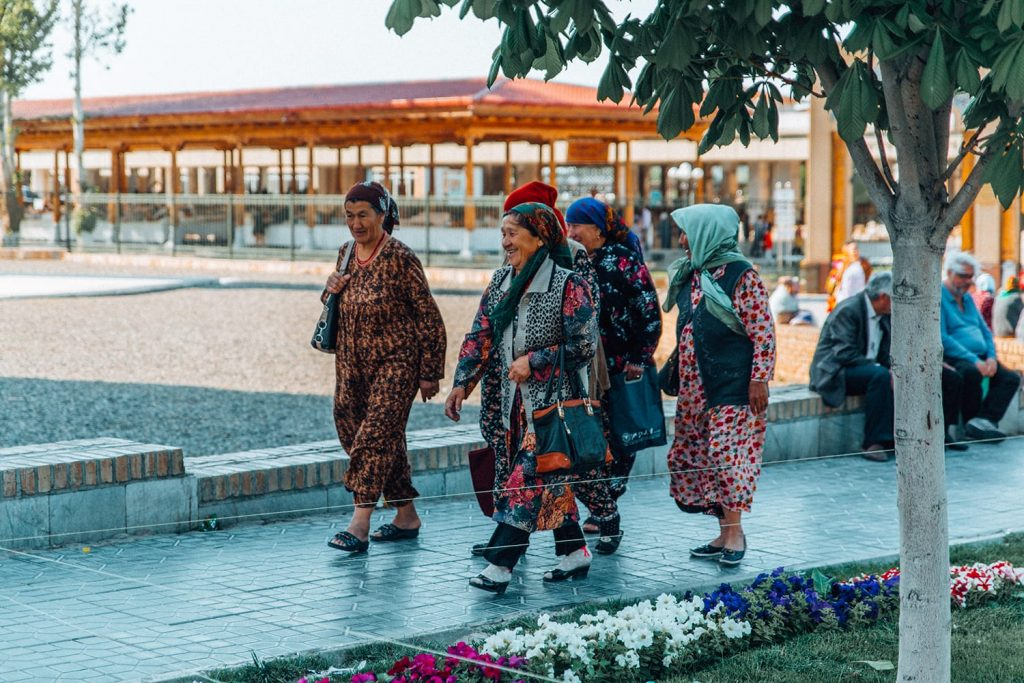 local ladies in colorful clothing walking on the street of uzbekistan