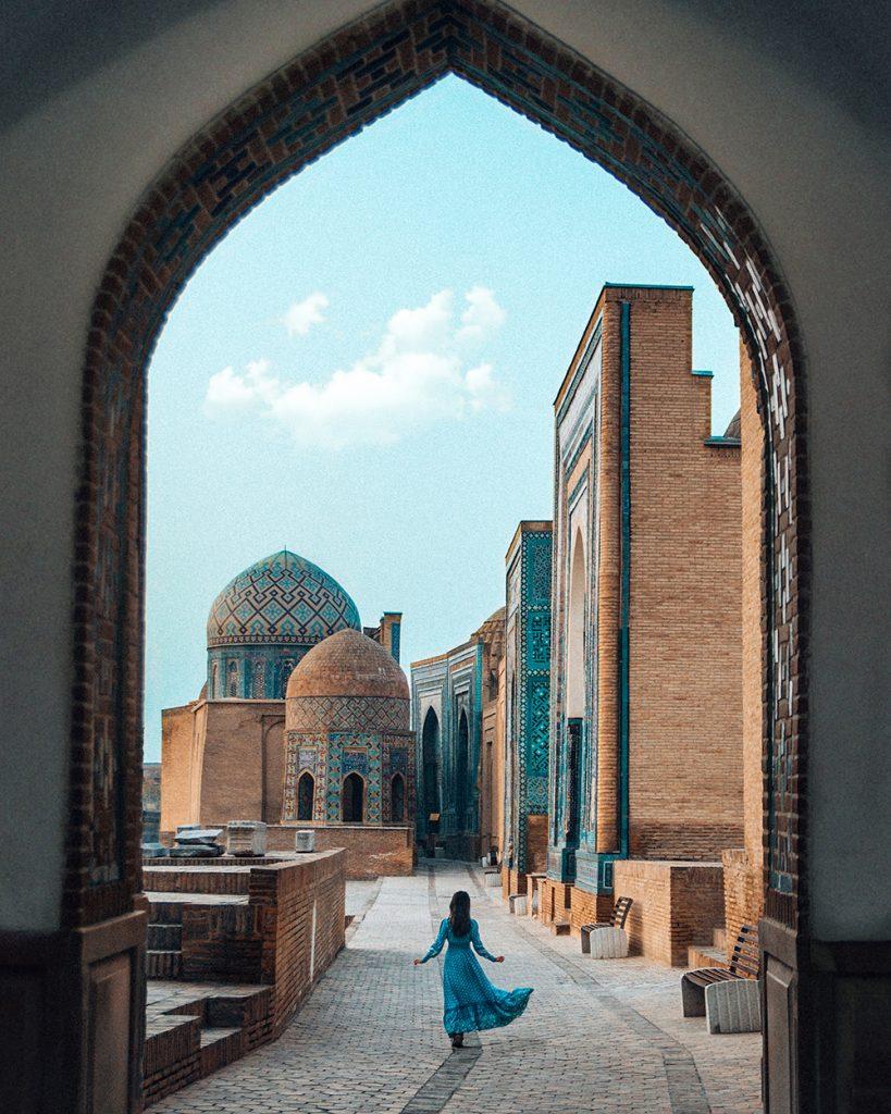 girl walking in avenue of shah i zinda samarkand