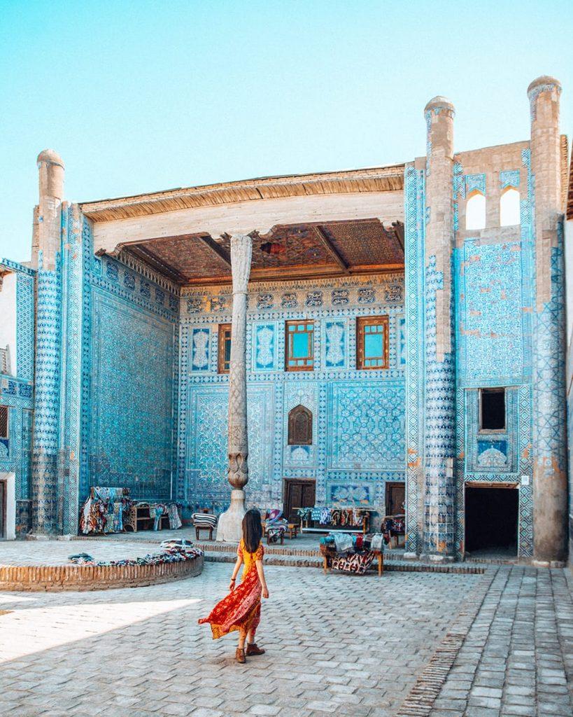 girl standing inside tash hauli palace in khiva uzbekistan