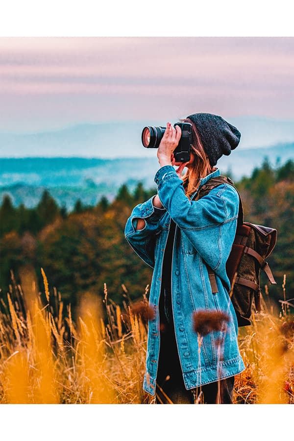 Girl Taking a Photo With One of the Best Cameras for Bloggers