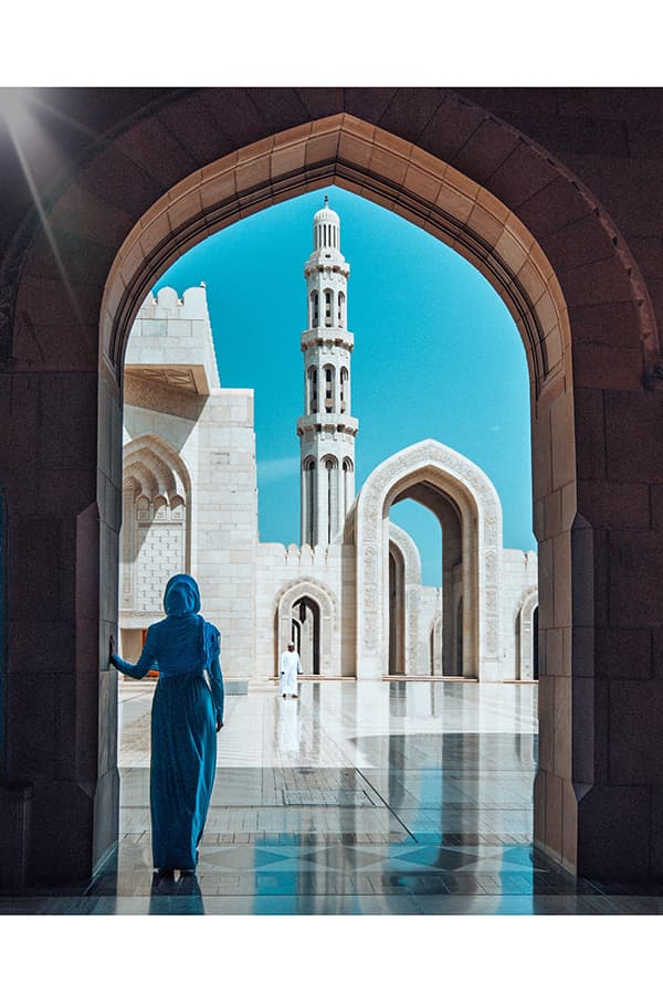 Tourist at Sultan Qaboos Grand Mosque in Muscat, Oman