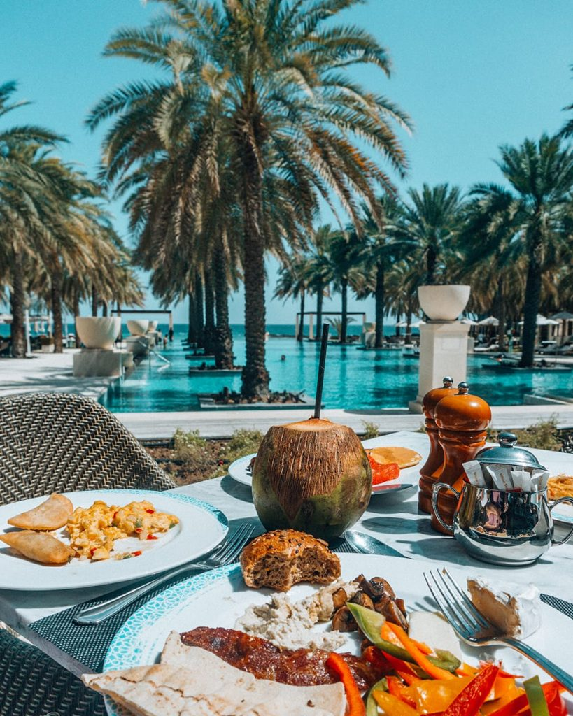 meal with a view of the pool in al bustan palace muscat