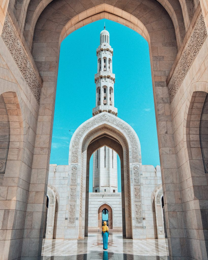 muscat girl standing inside sultan qaboos grand mosque