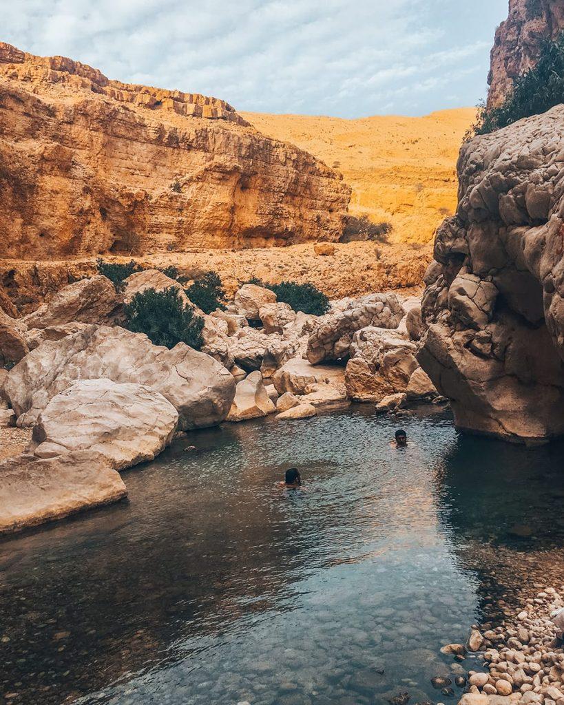 men swimming in wadi bani khalid