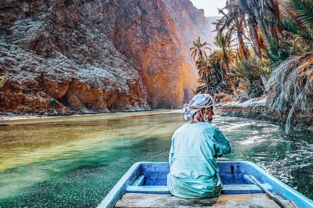 man on a boat in wadi shab