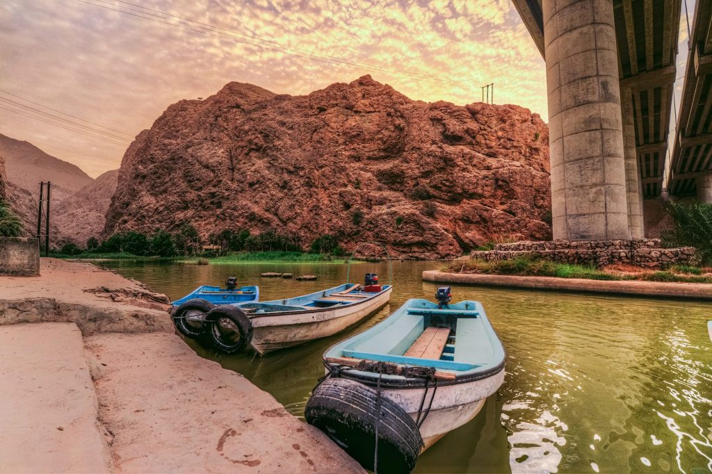 wadi shab boats by the river