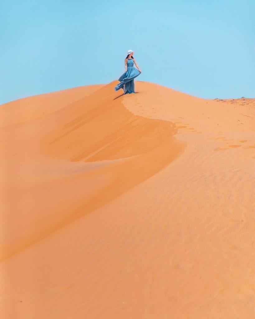girl standing on wahiba sands desert in oman
