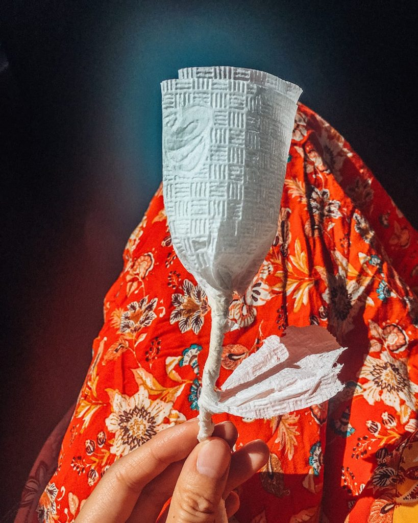 handmade paper napkin flower on a girls dress