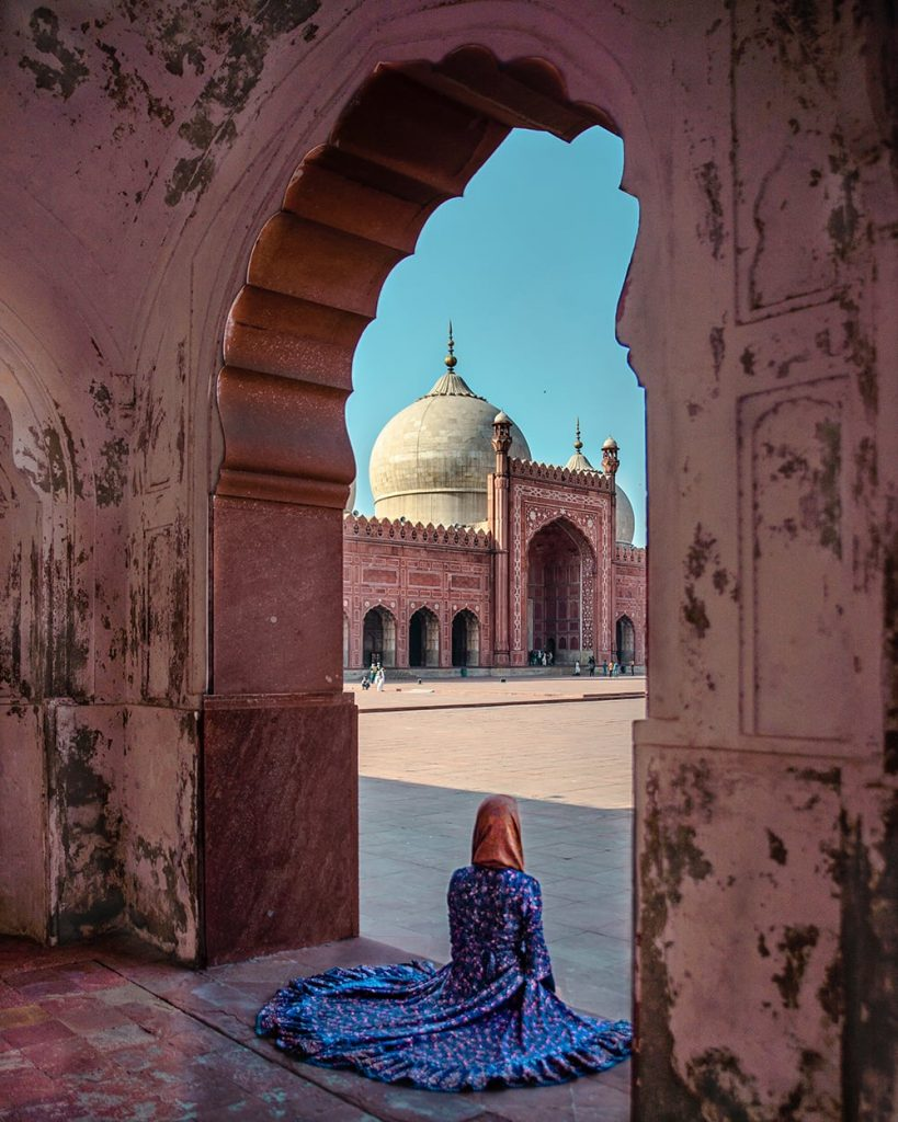 girl sitting in badshahi mosque in lahore pakistan