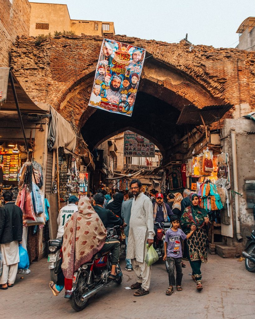 people shopping at a market at delhi gate in lahore pakistan