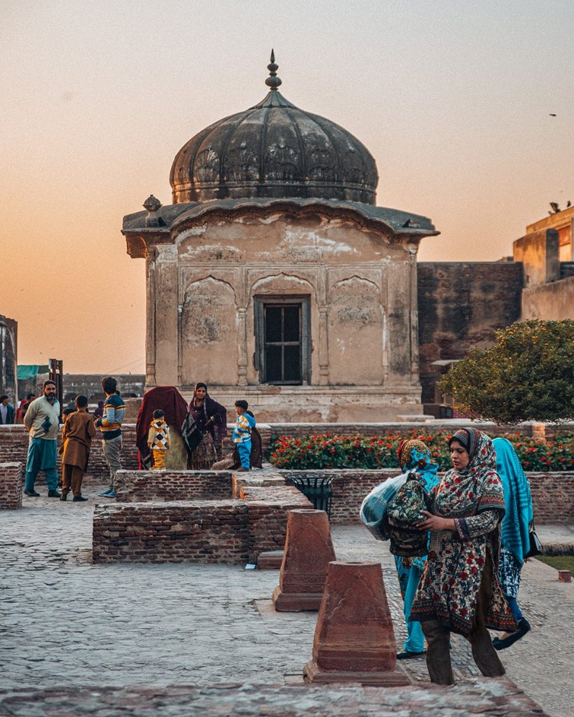 local woman walking in lahore fort pakistan