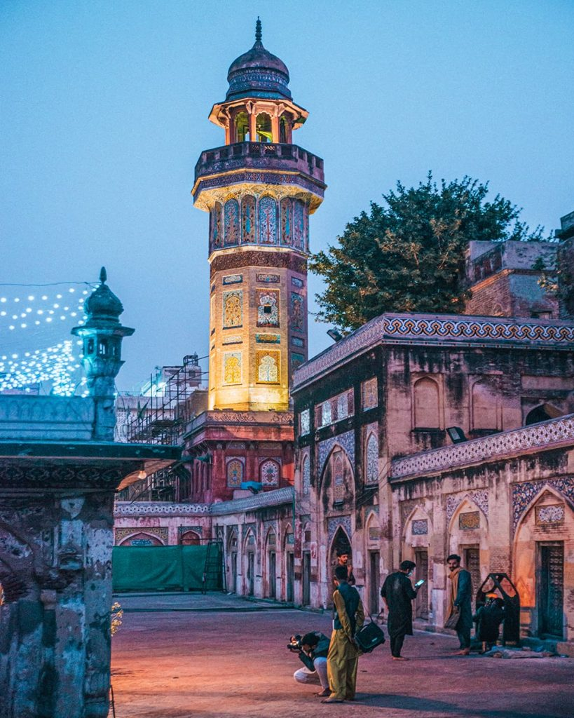 gilocals standing inside masjid wazir khan mosque in lahore pakistan after dark