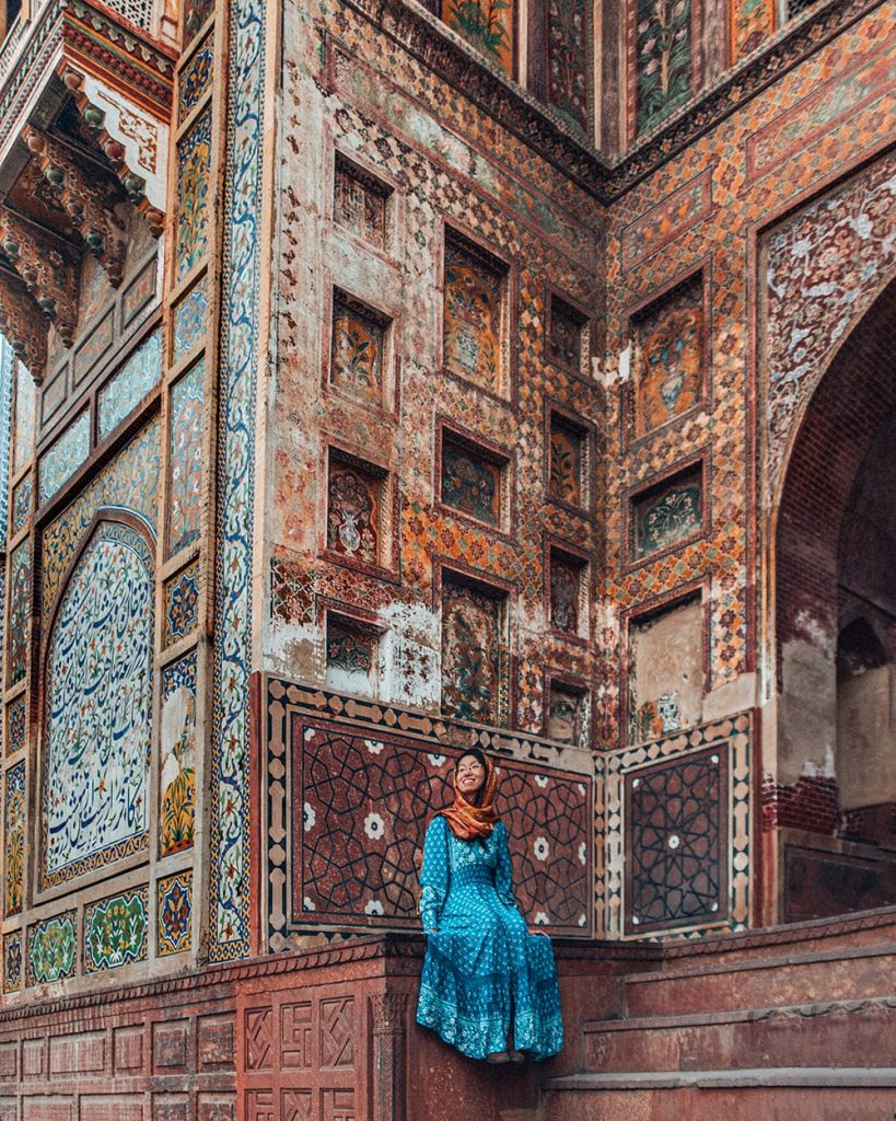 girl sitting at masjid wazir khan mosque in lahore pakistan