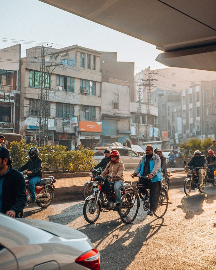 people riding bikes on a busy street in lahore pakistan