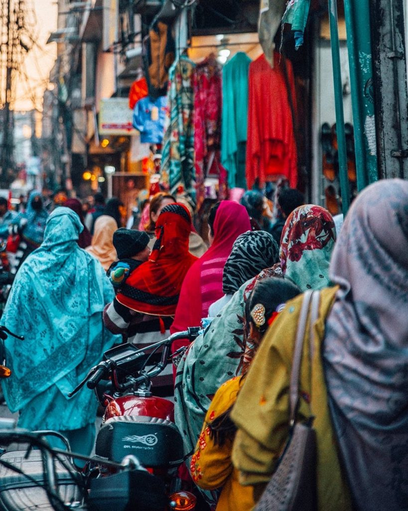 women wearing colorful headscarves walking on the streets