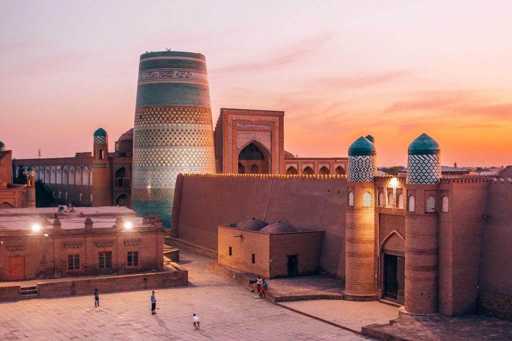 things to do in khiva uzbekistan minaret and madrasah in the city at sunset