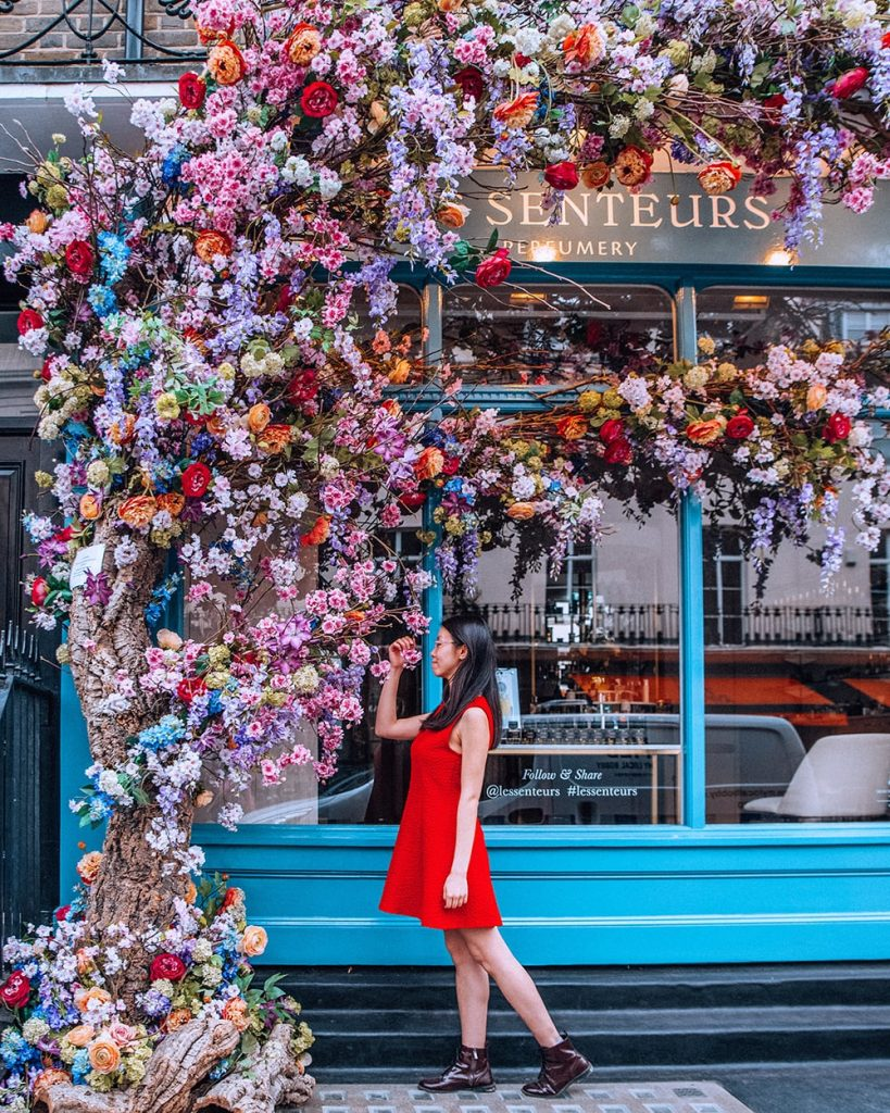 girl standing next to flowers in belgravia area of london