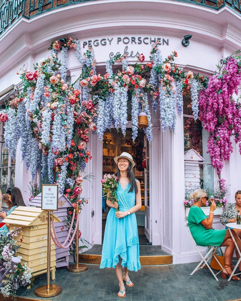standing standing in front of peggy porschen cupcake store in london