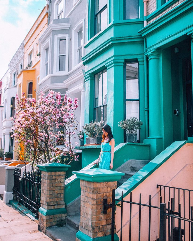 girl standing near colorful building in lancaster road in notting hill in the uk
