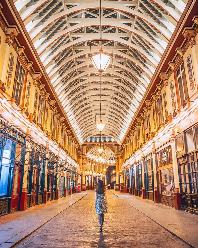 girl standing inside leadenhall market in london