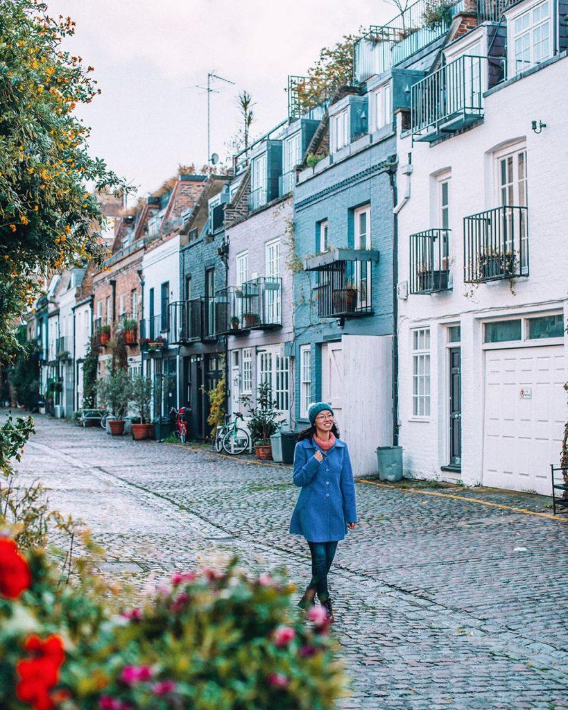 girl walking in st lukes mews in notting hill