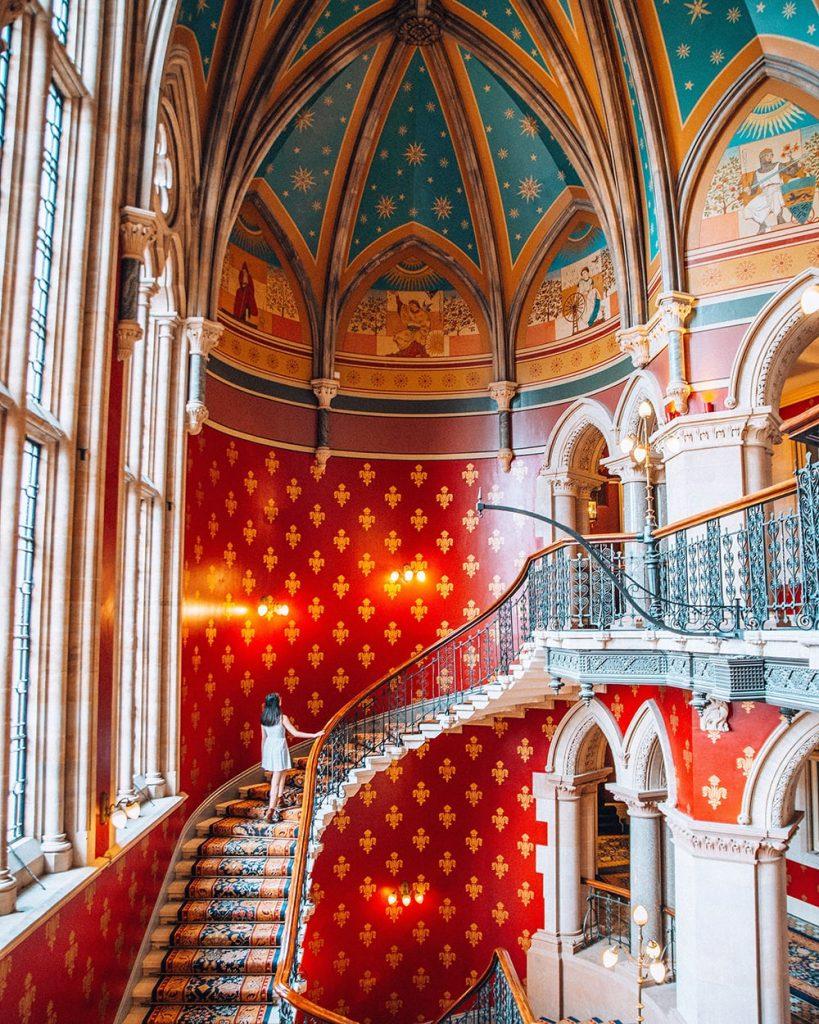girl walking up st pancras renaissance hotel staircase