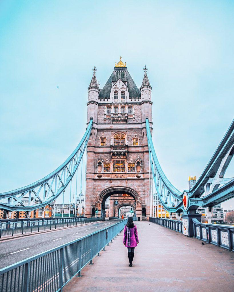 girl walking on tower bridge london