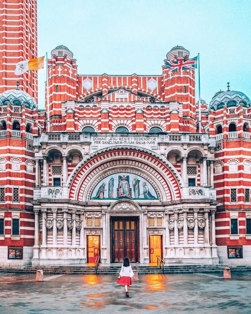 girl standing in front of westminster cathedral in london