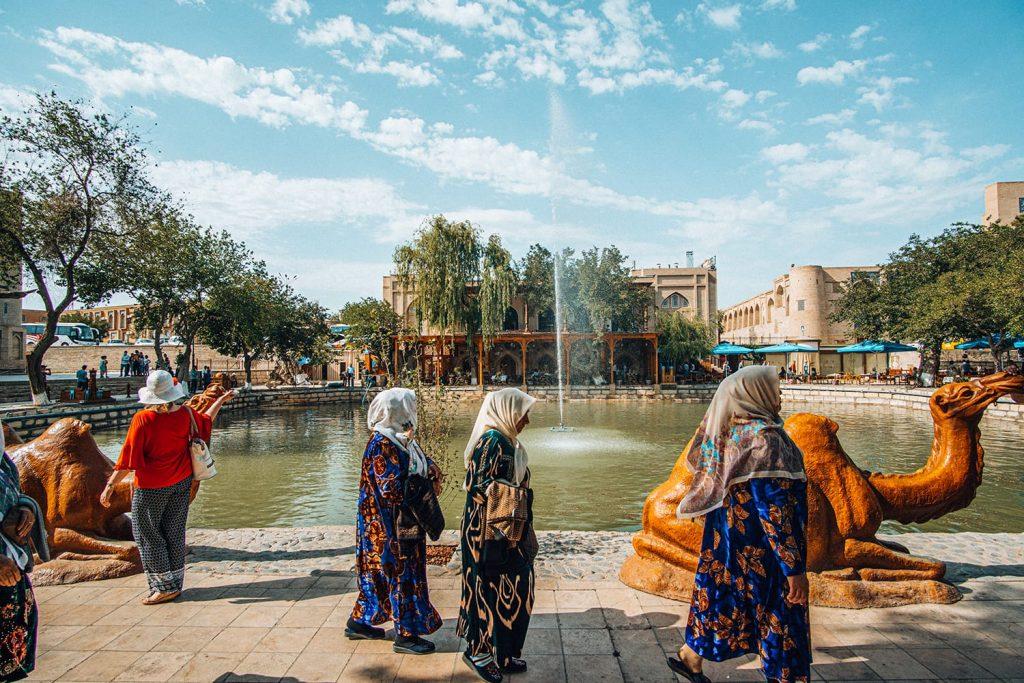 uzbekistan LYABI-HAUZ SQUARE pond locals walking by
