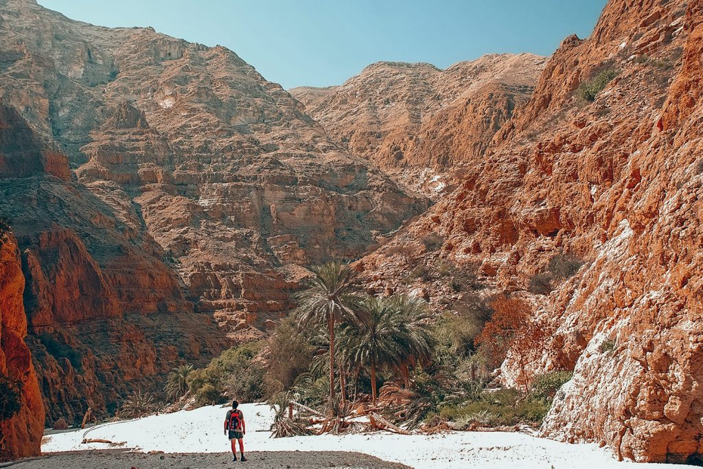 man hiking in wadi shab
