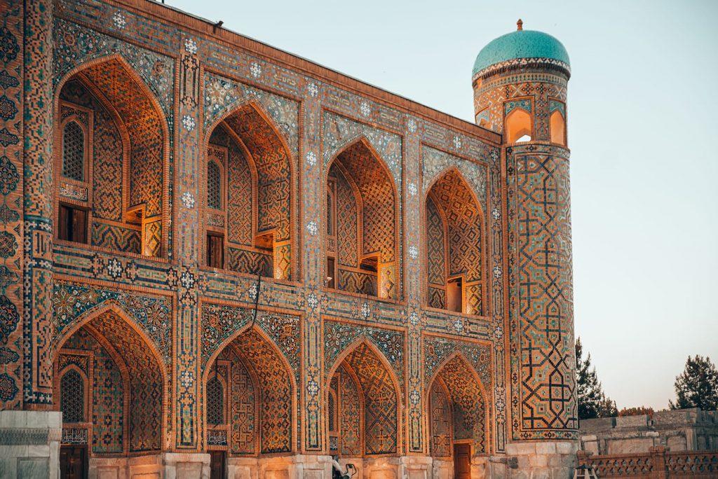 lit up tilework of madrasah in registan square uzbekistan