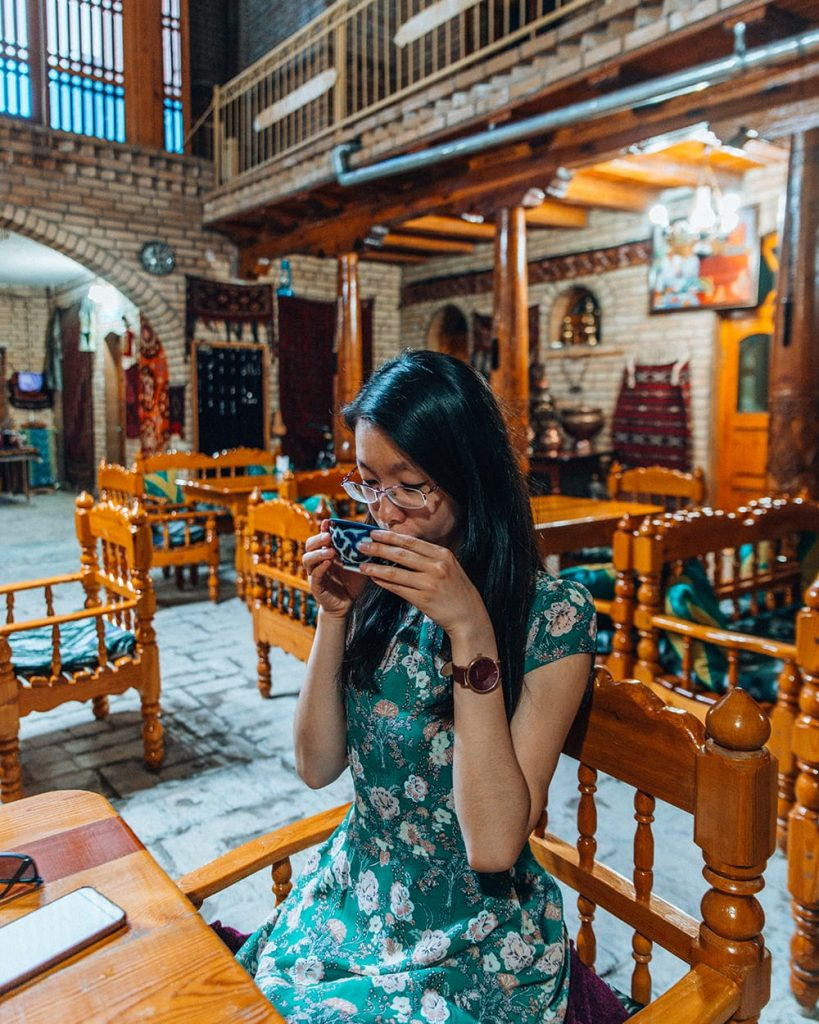 girl drinking tea in silk road tea house in uzbekistan