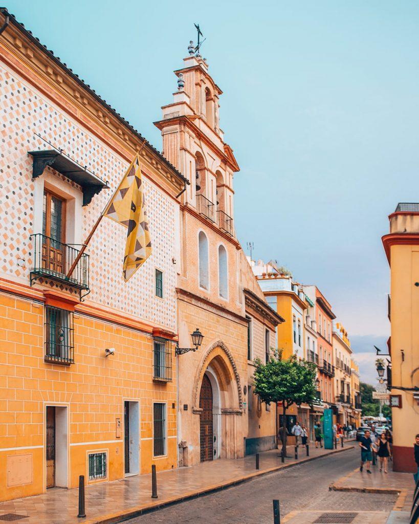 colorful buildings in the santa cruz neighborhood of seville spain