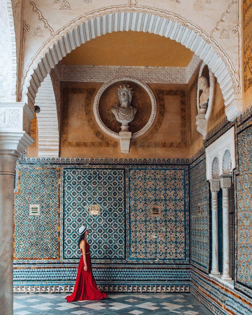 girl walking in casa de pilatos in seville spain