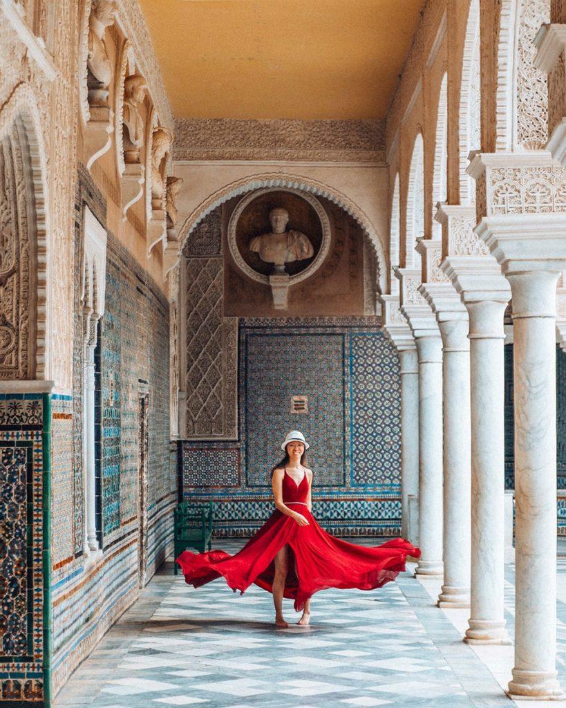 girl standing in casa de pilatos in seville spain
